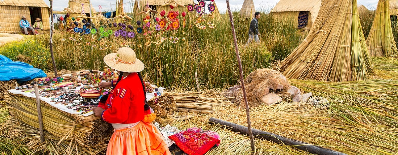 Woman in Latin America working in the field harvesting