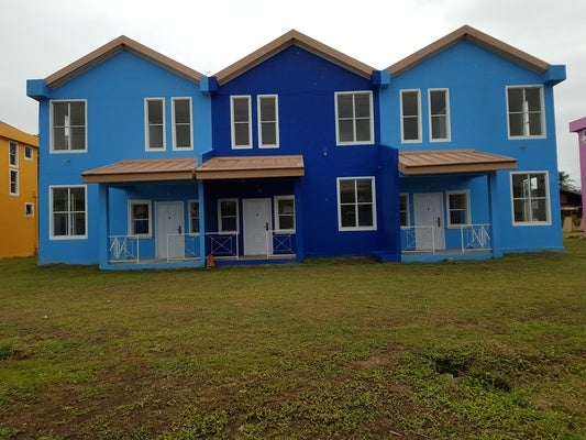 Beautiful blue houses in Trinidad and Tobago from an IDB Invest partnership project.