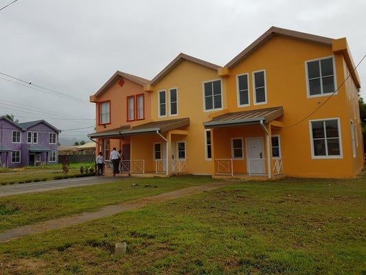 Beautiful yellow and orange houses in Trinidad and Tobago from an IDB Invest partnership project.