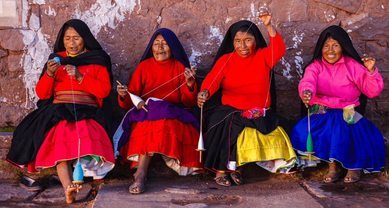 Very happy and cheerful indigenous women from Latin America dressed in typical clothes